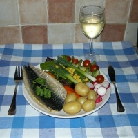 Fresh grilled mackerel with salad and a glass of white wine